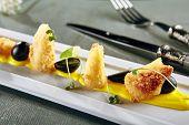 Restaurant Hot Starter Food - Deep Fried Camembert with Mango Sauce. Gourmet Restaurant Appetizers M poster