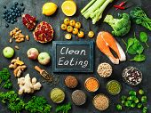 Clean Eating Concept. Selection Food Ingredients And Chalkboard With Clean Eating Words On Dark Back poster