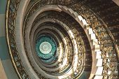 Spiral Staircase From Top To Down Decor Design In Europe Style. poster