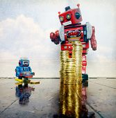 Economic inequality concept with big red robot and little blue one poster