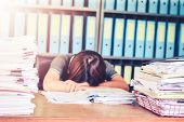 Blurred Business Woman Asleep On Office Desk At Office Desk With F Paperwork Stack Documents And Fin poster