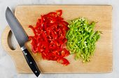 Chopped Red And Green Bell Pepper On Cutting Board. Step By Step Cooking Stir Fry poster