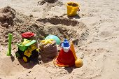 Childrens Beach Toys On Sand On A Sunny Day. poster