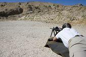 pic of shooting-range  - Closeup of a man in shooting position on shooting range - JPG