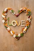 stock photo of satsuma  - Fresh sliced fruit heart shaped for Valentines Day  - JPG