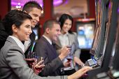 picture of gambler  - Young people enjoying to play slot machines at casino - JPG