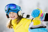 Skiing, winter, teenage girl  - young skier in winter resort