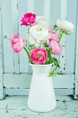 picture of vase flowers  - White and pink ranunculus flowers on light blue vintage chair - JPG