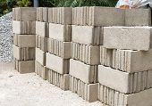 stock photo of cinder block  - Pile of Concrete Block with granite rock - JPG