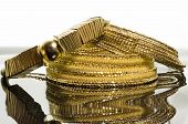 picture of chokers  - Three elegant gold necklaces for women over white hand and dark background - JPG