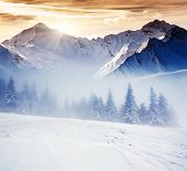 stock photo of snow clouds  - Fantastic evening winter landscape - JPG