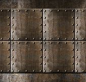 stock photo of ironclad  - metal armour background with rivets - JPG