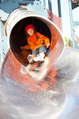 Little Girl In Playground Tube