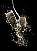stock photo of squirting  - Glasses of champagne with splash - JPG