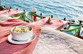 stock photo of wanton  - Vegetarian wanton soup on the table with ocean view in restaurant - JPG