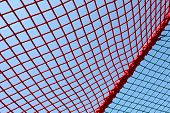 foto of safety barrier  - safety red net against the blue sky - JPG