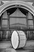 image of pipe organ  - Large Bass Drum sitting on stage in front of Pipe Organ - JPG