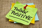 think positive  - motivational reminder - handwriting on sticky note