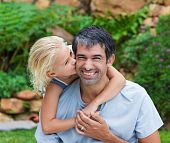 picture of father daughter  - Daughter Kissing Her Father In The Garden - JPG