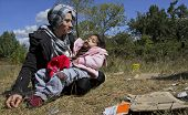 SOFIA, BULGARIA, 20 SEPTEMBER 2013 - Unknown Syrian mother, holding her sick child is sitting on the