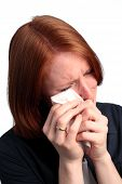 stock photo of sob  - A young woman wiping away her tears with a tissue - JPG