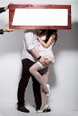 stock photo of lewd  - Couple and Board with White Blank Space - JPG