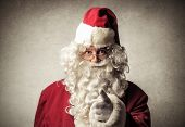 portrait of Santa Claus pointing with his finger