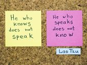 stock photo of interpreter  - famous Lao Tzu quote interpretation with sticker notes on cork board - JPG
