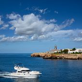 Ciutadella Sa Farola Lighthouse with yatch boat in Balearic islands