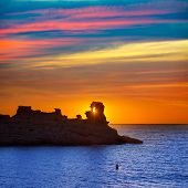 picture of morels  - Menorca sunset in Cala Morell at Ses torretes beach Balearic Islands - JPG