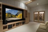 stock photo of home theater  - home theater with wine tasting room big screen wood cabinetsphoto on screen is one of my shots from yosemite - JPG