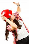foto of dread head  - a girl in a red helmet with dread looks up at white background in a shirt in a cell - JPG