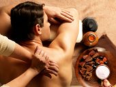 image of backbone  - Masseur doing massage of backbone on man body in the spa salon - JPG