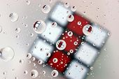 stock photo of brain teaser  - The red and white business end of a puzzle cube - JPG