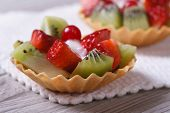 Two Fruit Tartlets With Strawberries, Kiwi And Cranberries