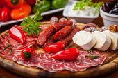 stock photo of catering  - Antipasti and catering platter with different meat and cheese products - JPG