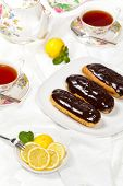 stock photo of eclairs  - Delicious homemade eclairs with a chocolate ganache - JPG