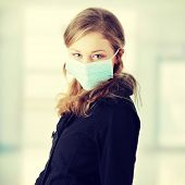 pic of swine flu  - A model wearing a mask to prevent  - JPG