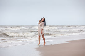 picture of nu  - Beautiful young seminude woman in the cold sea waves - JPG