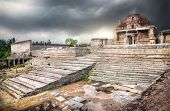pic of vijayanagara  - Ancient ruins of Vijayanagara Empire at dramatic overcast sky in Hampi Karnataka India - JPG