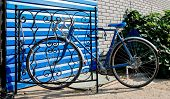 picture of bicycle gear  - City bicycle fixed gear and blue wall - JPG