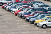 image of parking lot  - View of a parking lot with many cars in rows - JPG