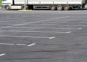 foto of truck-stop  - View of empty parking lot with parked truck - JPG