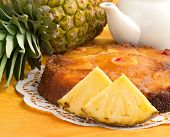foto of upside  - upside down cake and fresh pineapple on orange tablecloth - JPG