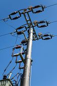 image of transformer  - Energy and technology: electrical post by the road with power line cables, transformers against