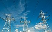 stock photo of electricity pylon  - Electric line power tower on background blue sky - JPG