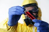 stock photo of sudan  - A man wearing full biological suite holding laboratory equipment - JPG