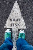 stock photo of snickers  - Green shoes standing on your risk sign - JPG