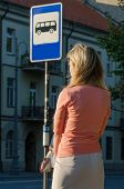 pic of bus-shelter  - Young sexy woman waiting for the bus - JPG