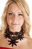image of chokers  - a woman looking wearing a black flower choker - JPG